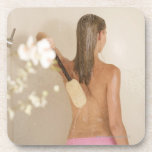 A young woman in a shower coaster