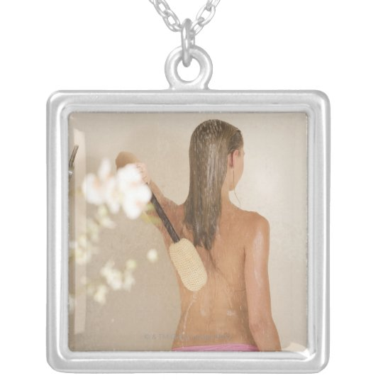 A young woman in a shower silver plated necklace