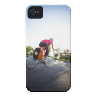 A young woman rides a bike around a park at iPhone 4 case