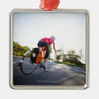 A young woman rides a bike around a park at metal ornament