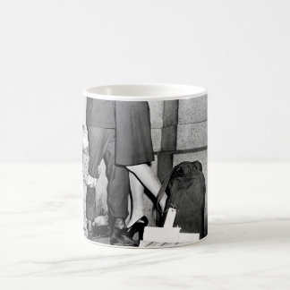 A youngster, clutching his soldier_War Image Coffee Mug