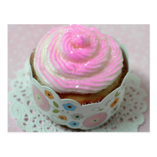A yummy cupcake with pink frosting and sparkles postcard