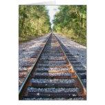 Abajo de las pistas de ferrocarril tarjetón