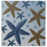 Abajo por las estrellas de mar del mar servilleta de papel