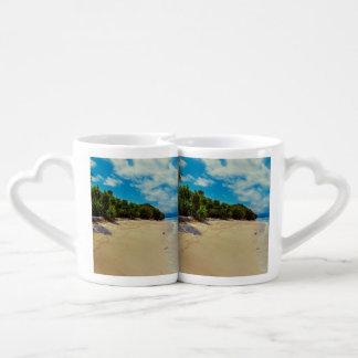 Abandonded beach couples' coffee mug set
