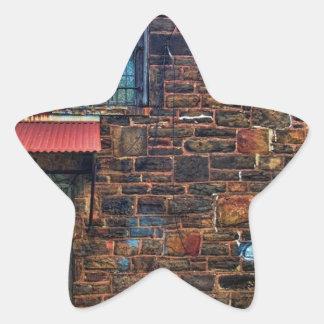 Abandoned Graffiti Brick Building Barred Windows Star Sticker
