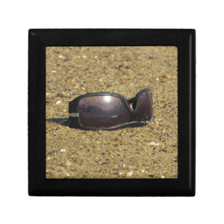 Abandoned sunglasses at Sandy Point Gift Box