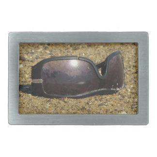 Abandoned sunglasses at Sandy Point Rectangular Belt Buckle