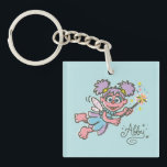 """Abby Cadabby Flying Keychain<br><div class=""""desc"""">Check out this flying Abby Cadabby with her magical wand.        This item is recommended for ages 13 .&#169;  &#169;  2014 Sesame Workshop. www.sesamestreet.org</div>"""