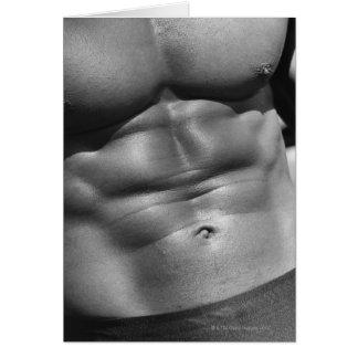 Abdomen definido del bodybuilder tarjetas