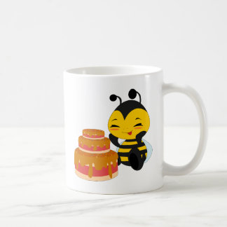 Abeja de la miel con la torta - taza