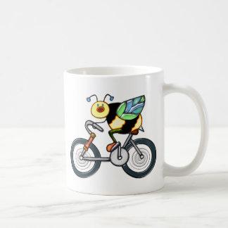 Abeja en una bici tazas