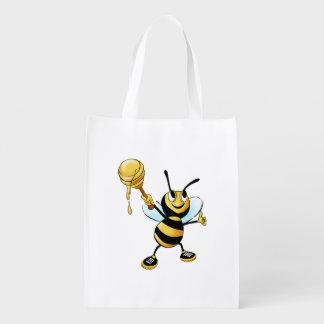 Abeja sonriente de la miel del dibujo animado que bolsas reutilizables