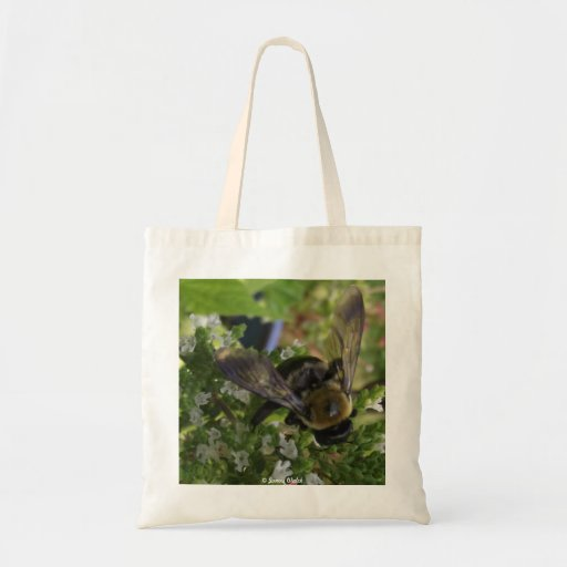 Abeja y flor blanca bolsa