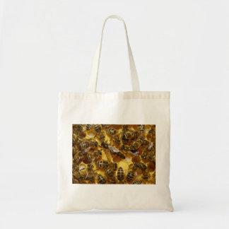 Abejas de la miel en colmena con la reina en centr bolsa tela barata
