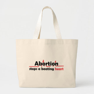 Abortion stops a beating heart tote bags