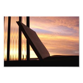 Abra el libro y la fotografía de la puesta del sol cojinete