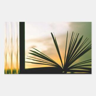Abra la fotografía del libro y de la puesta del pegatina rectangular