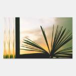 Abra la fotografía del libro y de la puesta del so pegatina