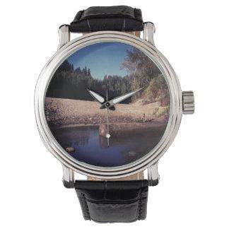 Abra una sesión una charca relojes de mano