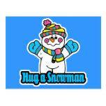 abrace un muñeco de nieve tarjetas postales
