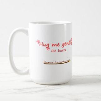 Abráceme asaltan suavemente taza de café