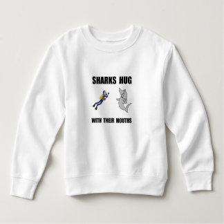Abrazo de los tiburones camisas