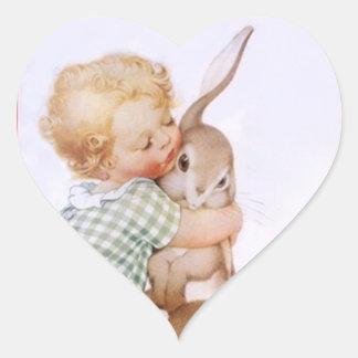 Abrazos de conejito adorables antiguos de pascua pegatina en forma de corazón