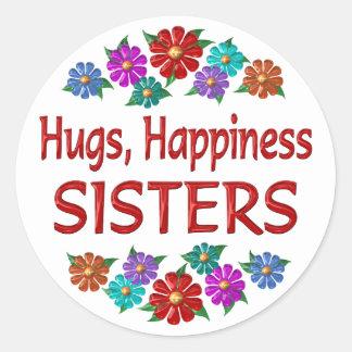 Abrazos de la hermana pegatina redonda