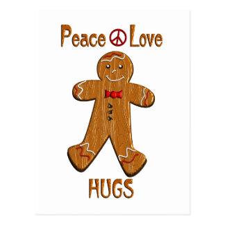 Abrazos del amor de la paz postal
