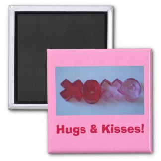 Abrazos y imán de los besos