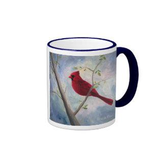 abrigo cardinal alrededor de la taza