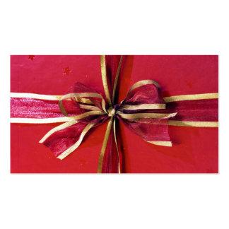 Abrigo y arcos de regalo de vacaciones tarjetas de visita