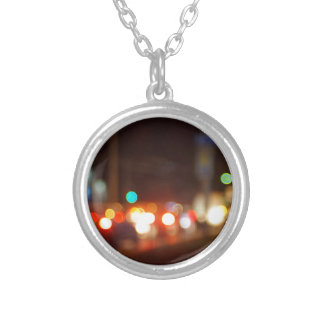 Abstract blur image of a night scene with bright l round pendant necklace