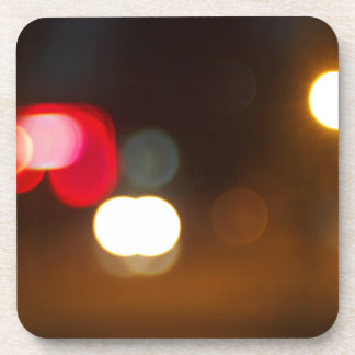 Abstract blur image of round spots of bright multi coaster