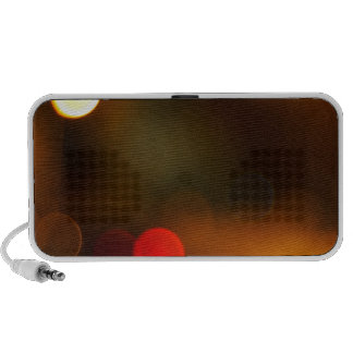 Abstract blur image of round spots of bright multi portable speaker