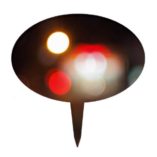Abstract blurred image of circular lights on the n cake topper