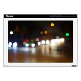 Abstract blurry spots of light in the night city laptop skins