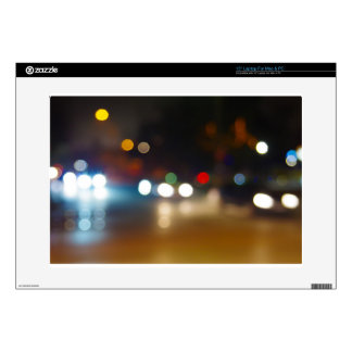 Abstract blurry spots of light in the night city skins for laptops
