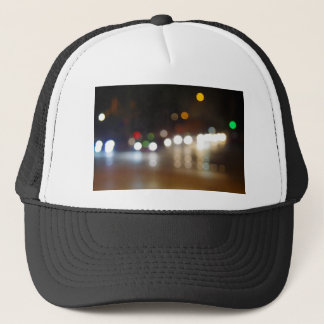 Abstract blurry spots of light in the night city trucker hat