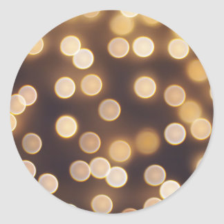 Abstract defocused and blur bokeh of small yellow classic round sticker