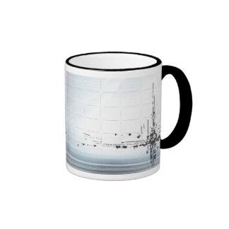 Abstract designs on grid ringer mug