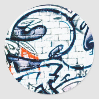 Abstract Graffiti on the brick wall Classic Round Sticker