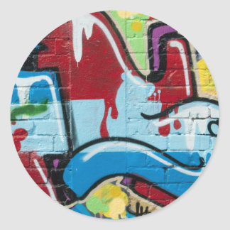 Abstract Graffiti on the textured Brick Wall Classic Round Sticker