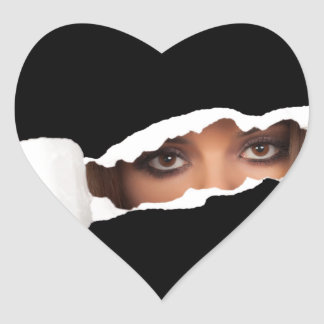 Abstract image of a woman's eyes. heart sticker