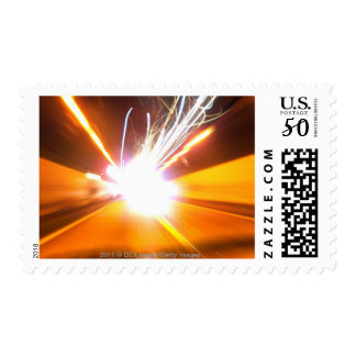 Abstract light beams and effects postage