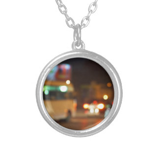 Abstract night scene with bus and headlights round pendant necklace