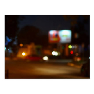 Abstract night scene with dim lights and headlight postcard