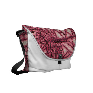 Abstract pattern on leather courier bag