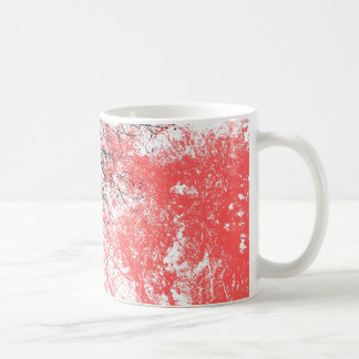 Abstract tree branches in black and orange coffee mug